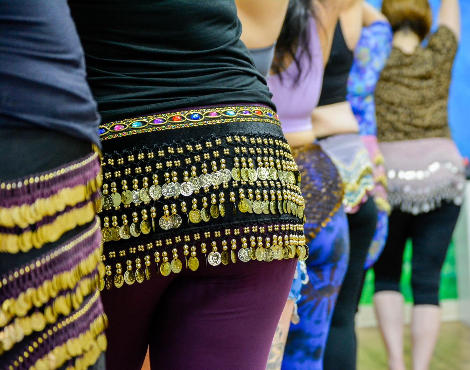 Belly dance students wearing hip scarves in Phoenix belly dance class