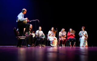 Middle eastern percussion group performing on stage